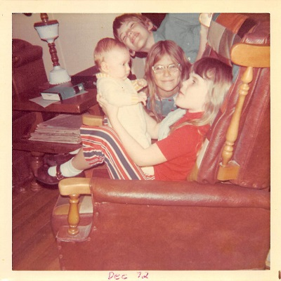 1972_12 Holding Baby Ronny